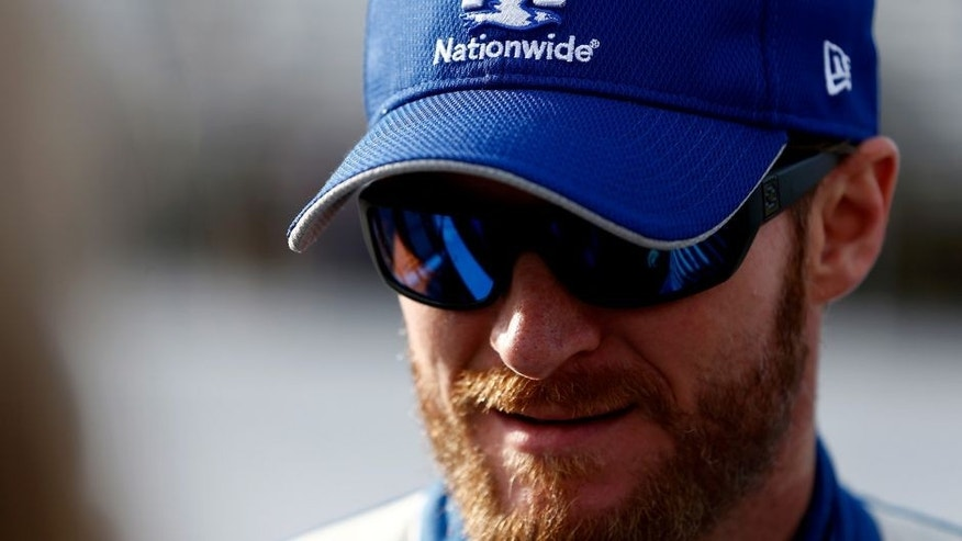 LOUDON, NH - SEPTEMBER 25: Dale Earnhardt Jr., driver of the #88 Nationwide Chevrolet, stands on the grid during qualifying for the NASCAR Sprint Cup Series Sylvania 300 at New Hampshire Motor Speedway on September 25, 2015 in Loudon, New Hampshire. (Photo by Jeff Zelevansky/Getty Images)