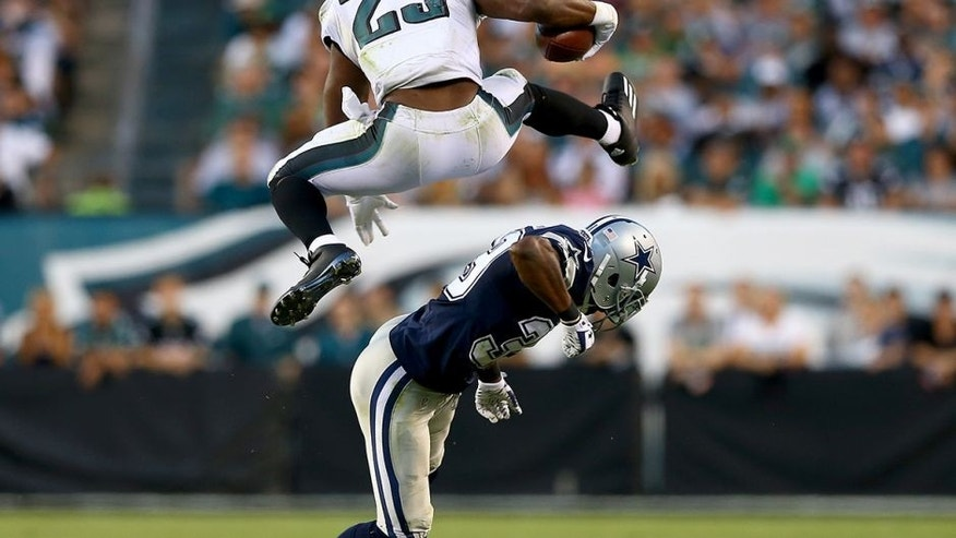 PHILADELPHIA, PA - SEPTEMBER 20: DeMarco Murray #29 of the Philadelphia Eagles leaps over Brandon Carr #39 of the Dallas Cowboys in the third quarter on September 20, 2014 at Lincoln Financial Field in Philadelphia, Pennsylvania.The Dallas Cowboys defeated the Philadelphia Eagles 20-10. (Photo by Elsa/Getty Images)