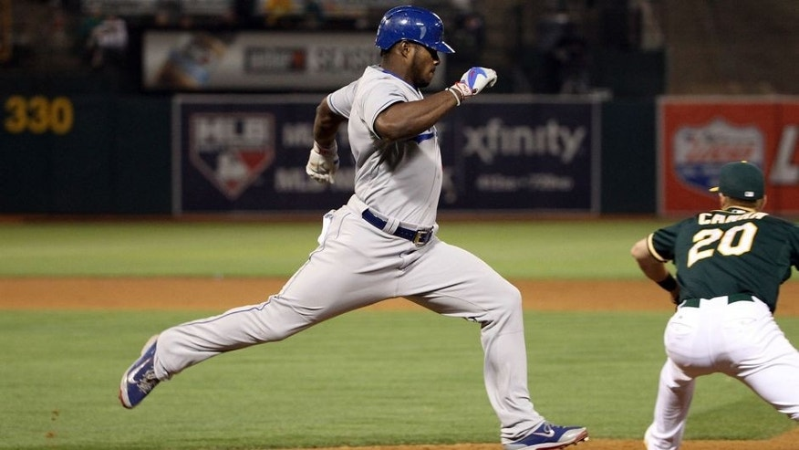 OAKLAND, CA - AUGUST 18: Yasiel Puig #66 of the Los Angeles Dodgers runs to first base against the Oakland Athletics at O.co Coliseum on August 18, 2015 in Oakland, California. (Photo by Ezra Shaw/Getty Images)