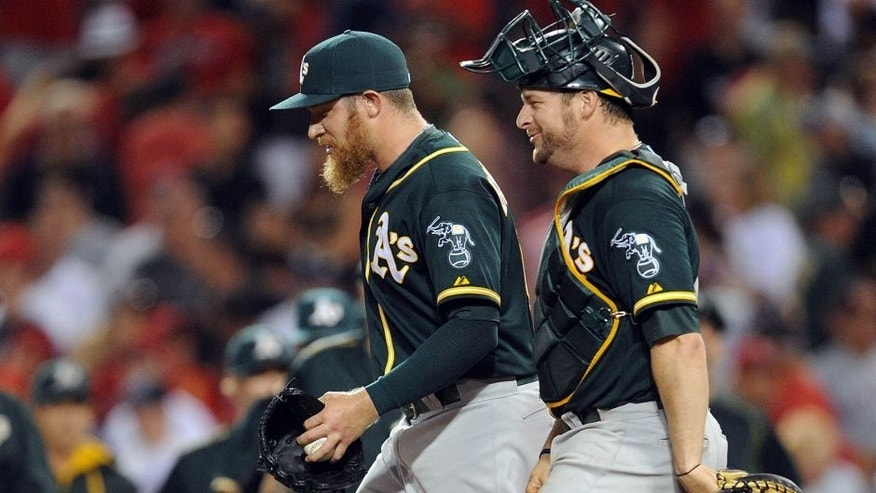 September 30, 2015; Anaheim, CA, USA; Oakland Athletics relief pitcher Sean Doolittle (62) and catcher Stephen Vogt (21) celebrate the 8-7 victory against the Los Angeles Angels at Angel Stadium of Anaheim. Mandatory Credit: Gary A. Vasquez-USA TODAY Sports