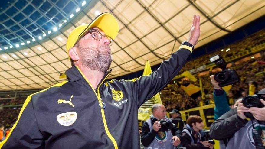 BERLIN, GERMANY - May 30: Head coach Juergen Klopp of Borussia Dortmund is saying goodbye to his fans after the final whistle during the DFB Cup Final match between Borussia Dortmund and VfL Wolfsburg at Olympiastadion on May 30, 2015 in Berlin, Germany. (Photo by Alexandre Simoes/Borussia Dortmund/Getty Images)
