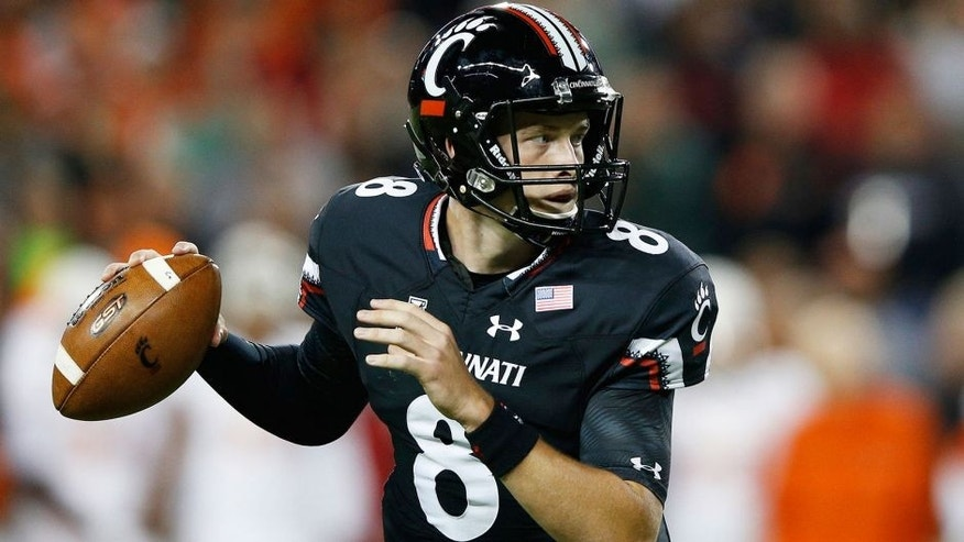CINCINNATI, OH - OCTOBER 1: Hayden Moore #8 of the Cincinnati Bearcats looks to pass against the Miami Hurricanes in the first half at Nippert Stadium on October 1, 2015 in Cincinnati, Ohio. (Photo by Joe Robbins/Getty Images)