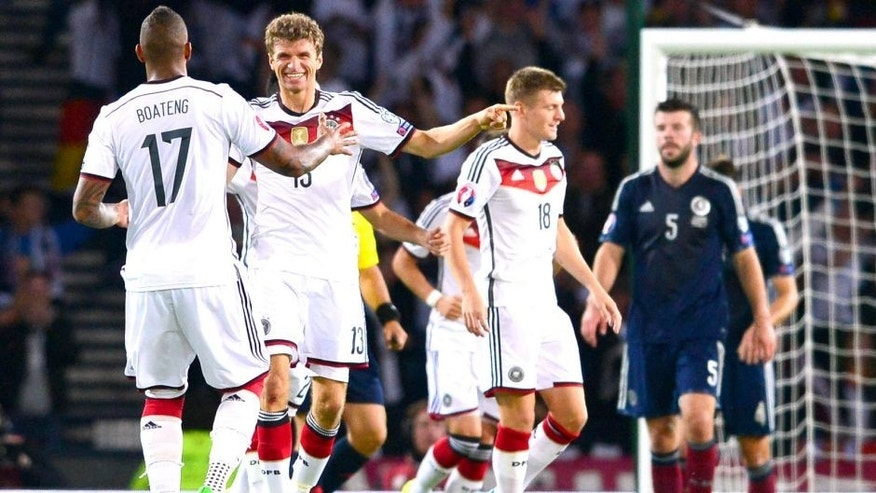 GLASGOW, SCOTLAND - SEPTEMBER 7 : Thomas Muller celebrates with his team mates after the German second goal during the EURO 2016 Qualifier between Scotland and Germany at Hamden Park on September 7, 2015 in Glasgow, Scotland. (Photo by Mark Runnacles/Getty Images)