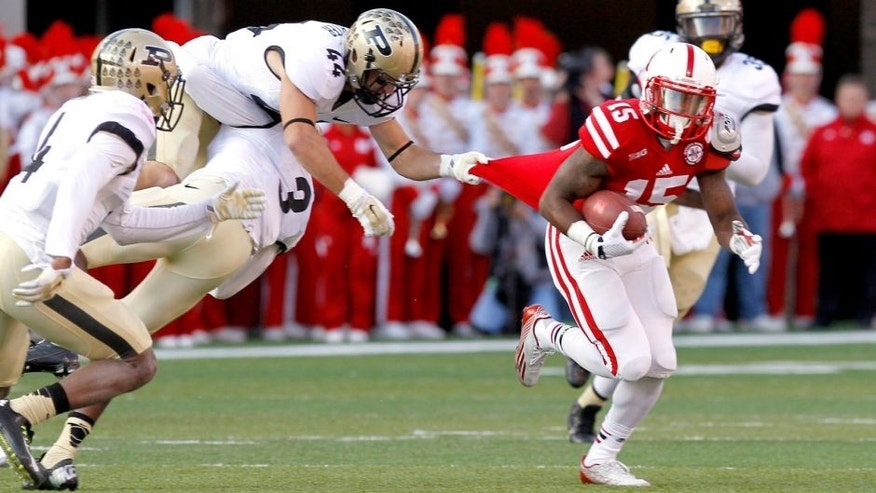 Nov 1, 2014; Lincoln, NE, USA; Nebraska Cornhuskers receiver De'Mornay Pierson-El (15) pulls away from Purdue Boilermakers defender Landon Feichter (15) in the first half at Memorial Stadium. Mandatory Credit: Bruce Thorson-USA TODAY Sports