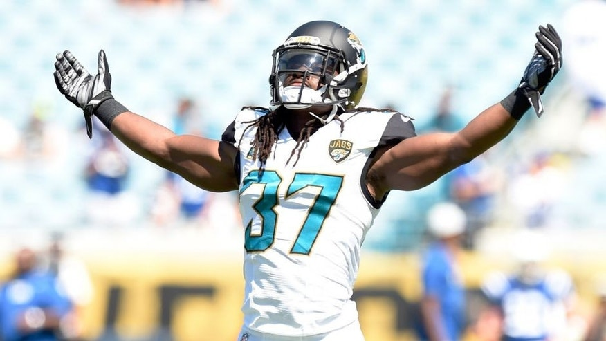 Sep 21, 2014; Jacksonville, FL, USA; Jacksonville Jaguars strong safety Johnathan Cyprien (37) gestures to the crowd during pre game warmups before their matchup against the Indianapolis Colts at EverBank Field. Mandatory Credit: John David Mercer-USA TODAY Sports