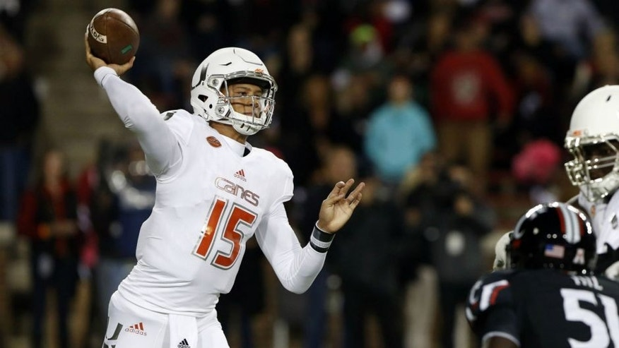 <p>Oct 1, 2015; Cincinnati, OH, USA; Miami Hurricanes quarterback Brad Kaaya (15) throws a pass in the first half against the Cincinnati Bearcats at Nippert Stadium. Mandatory Credit: Aaron Doster-USA TODAY Sports</p>