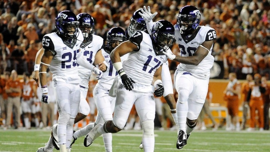 Nov 27, 2014; Austin, TX, USA; TCU Horned Frogs safety Sam Carter (17) celebrates with teammates after intercepting a pass against the Texas Longhorns during the game at Darrell K Royal-Texas Memorial Stadium. Mandatory Credit: Brendan Maloney-USA TODAY Sports