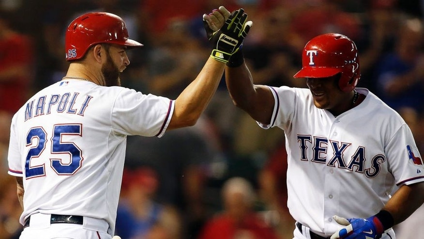 Sep 30, 2015; Arlington, TX, USA; Texas Rangers third baseman Adrian Beltre (29) is congratulated by first baseman Mike Napoli (25) after hitting a home run in the first inning against the Detroit Tigers at Globe Life Park in Arlington. Mandatory Credit: Tim Heitman-USA TODAY Sports