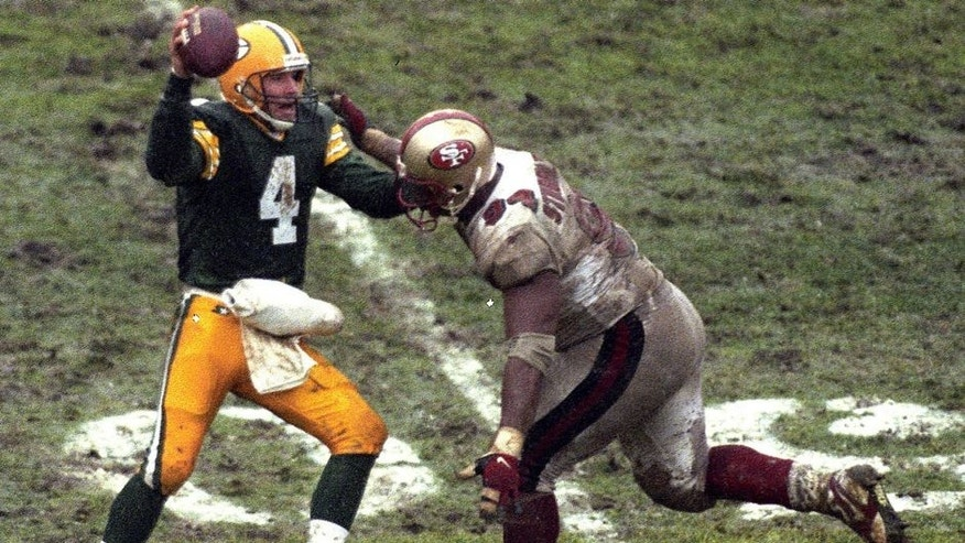 GREEN BAY, WI - JANUARY 4, 1997: Brett Favre #4 of the Green Bay Packers looks to pass during the NFL Divisional Playoff Game against the San Francisco 49ers on January 4, 1997 in Green Bay, Wisconsin. (Photo by Ronald C. Modra/Sports Imagery/Getty Images)