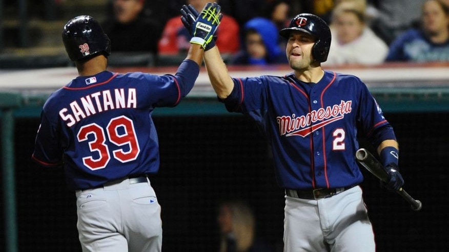 <p>Oct 1, 2015; Cleveland, OH, USA; Minnesota Twins shortstop Danny Santana (39) celebrates with Minnesota Twins second baseman Brian Dozier (2) after scoring during the eighth inning against the Cleveland Indians at Progressive Field. Mandatory Credit: Ken Blaze-USA TODAY Sports</p>