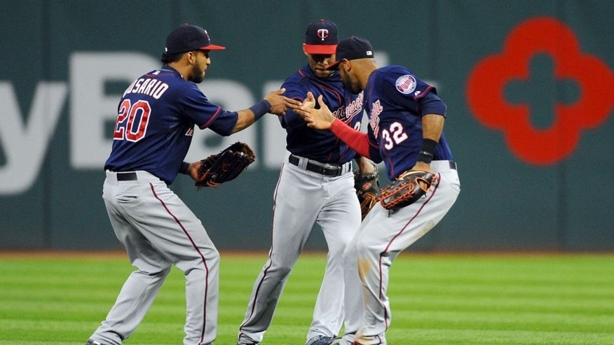 Oct 1, 2015; Cleveland, OH, USA; Minnesota Twins left fielder Eddie Rosario (20), center fielder Byron Buxton (25) and center fielder Aaron Hicks (32) celebrate the Twins 4-2 win over the Cleveland Indians at Progressive Field. Mandatory Credit: Ken Blaze-USA TODAY Sports