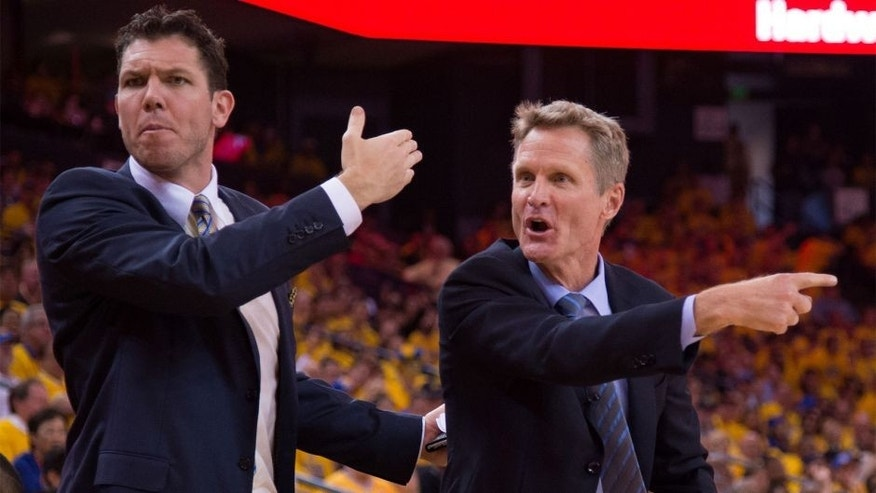 April 18, 2015; Oakland, CA, USA; Golden State Warriors assistant coach Luke Walton (left) and head coach Steve Kerr (right) react during the second quarter in game one of the first round of the NBA Playoffs against the New Orleans Pelicans at Oracle Arena. The Warriors defeated the Pelicans 106-99. Mandatory Credit: Kyle Terada-USA TODAY Sports