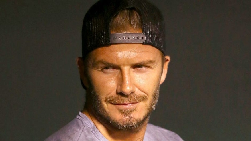 ANAHEIM, CA - AUGUST 20: Former professional soccer player David Beckham attends the MLB game between the Chicago White Sox and the Los Angeles Angels of Anaheim at Angel Stadium of Anaheim on August 20, 2015 in Anaheim, California. The White Sox defeated the Angels 8-2. (Photo by Victor Decolongon/Getty Images)