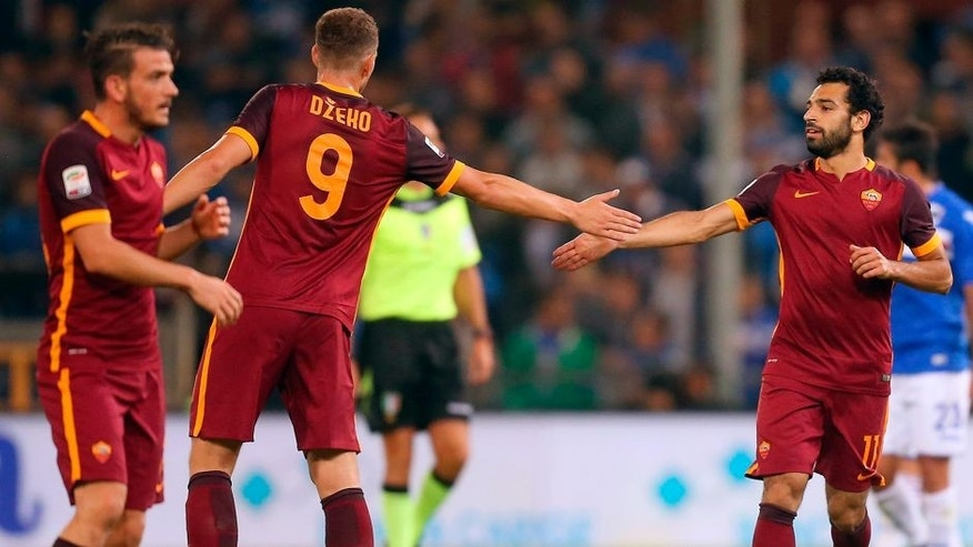 Roma's midfielder Mohamed Salah from Egypt (R) celebrates after scoring with Roma's forward Edin Dzeko from Bosnia-Herzegovina during the Italian Serie A football match Sampdoria vs Roma on September 23, 2015 at Luigi Ferraris Stadium in Genoa. Sampdoria won the match 2-1. AFP PHOTO / MARCO BERTORELLO (Photo credit should read MARCO BERTORELLO/AFP/Getty Images)