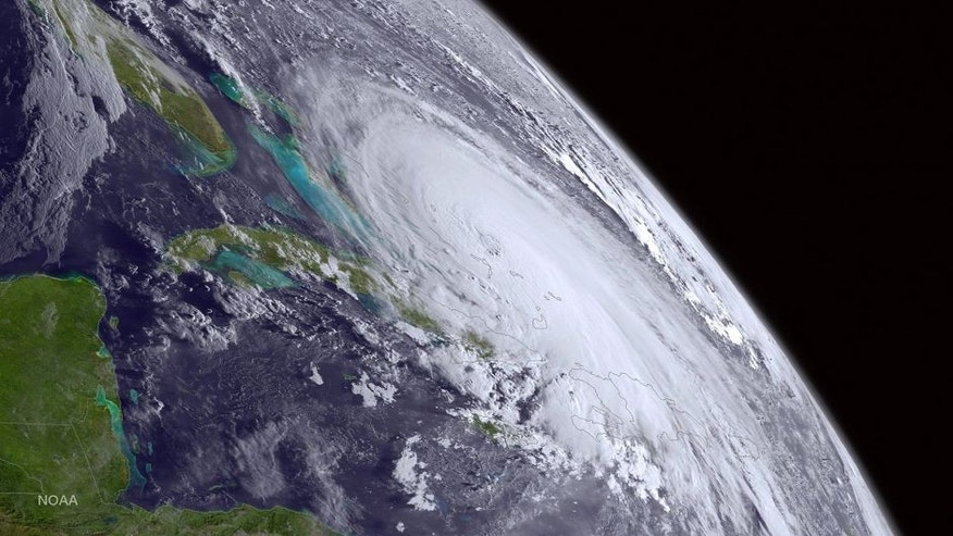 <p>This satellite image taken Thursday, Oct. 1, 2015 at 8 a.m. EDT, and released by the National Oceanic and Atmospheric Administration (NOAA), shows Hurricane Joaquin. The powerful Category 4 hurricane pounded lightly populated islands of the eastern Bahamas on Thursday, and forecasters said it could grow more intense while following a path that would near the U.S. East Coast by the weekend. (NOAA via AP)</p>