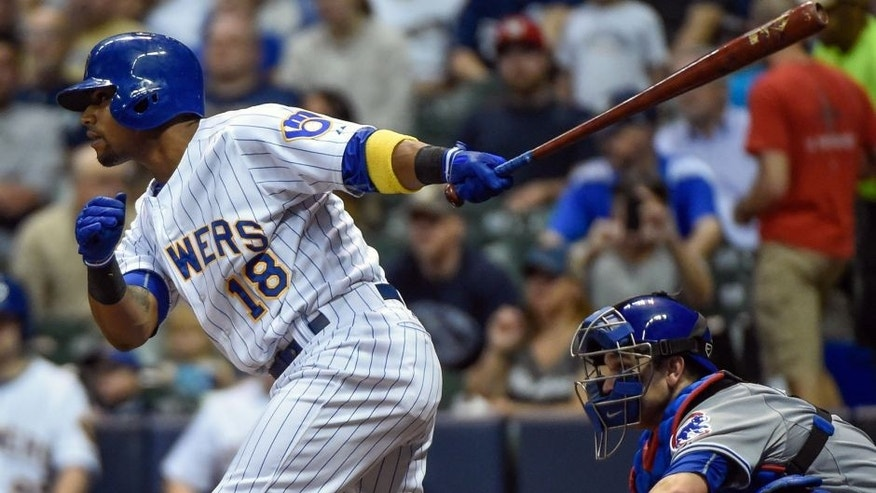 <p>May 8, 2015; Milwaukee, WI, USA; Milwaukee Brewers left fielder Khris Davis (18) drives in a run with a base hit in the first inning against the Chicago Cubs at Miller Park. Mandatory Credit: Benny Sieu-USA TODAY Sports</p>