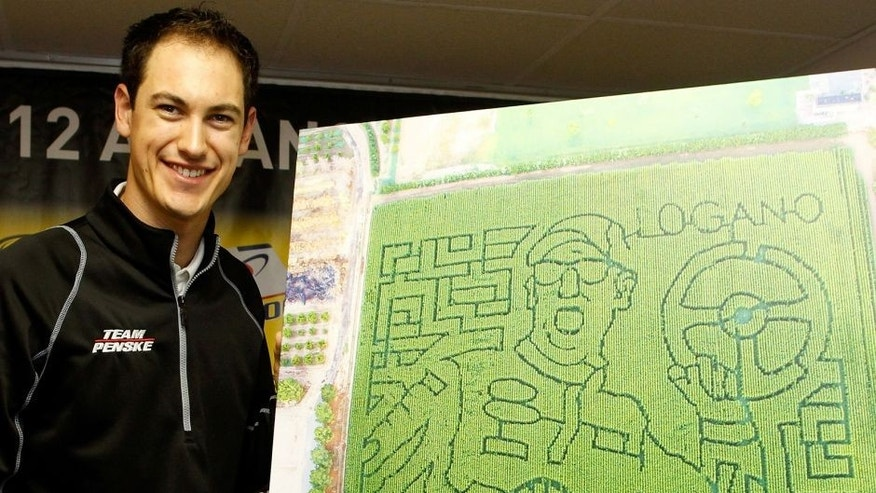 DOVER, DE - OCTOBER 02: Joey Logano, driver of the #22 Shell/Pennzoil Ford, speaks to the media before practice for the NASCAR Sprint Cup Series AAA 400 at Dover International Speedway on October 2, 2015 in Dover, Delaware. A corn maze of his likeness was created at a farm in Arizona. (Photo by Brian Lawdermilk/Getty Images)