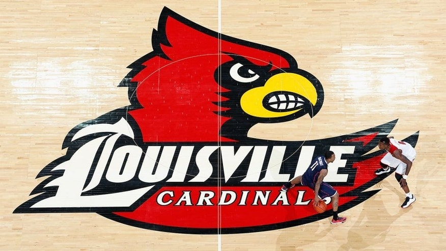 LOUISVILLE, KY - MARCH 8: General view of the Louisville Cardinals logo at midcourt as action takes place during the game against the Connecticut Huskies at KFC Yum! Center on March 8, 2014 in Louisville, Kentucky. Louisville won 81-48 to clinch a share of the American Athletic Conference championship. (Photo by Joe Robbins/Getty Images) *** Local Caption ***