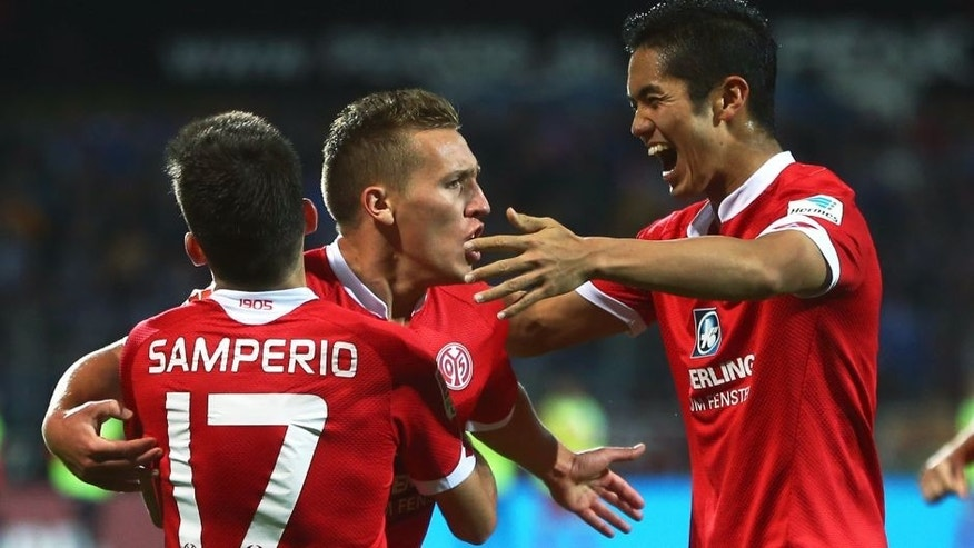 DARMSTADT, GERMANY - OCTOBER 02: Pablo de Blasis (C) of Mainz celebrates his team's third goal with team mates Yoshinori Muto (R) and Jairo Samperio during the Bundesliga match between SV Darmstadt 98 and 1.FSV Mainz 05 at Merck-Stadion am Boellenfalltor on October 2, 2015 in Darmstadt, Germany. (Photo by Alex Grimm/Bongarts/Getty Images)