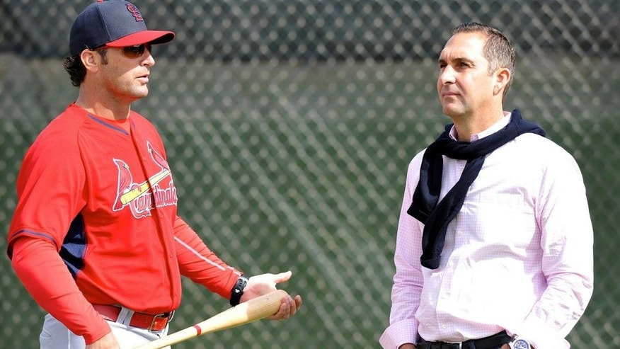 Feb 21, 2015; Jupiter, FL, USA; St. Louis Cardinals manager Mike Matheny (left) talks with Cardinals general manager John Mozeliak (right) during practice drills at Roger Dean Stadium. Mandatory Credit: Steve Mitchell-USA TODAY Sports