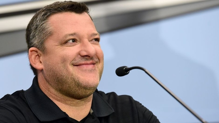 KANNAPOLIS, NC - SEPTEMBER 30: Tony Stewart, driver of the #14 Stewart-Haas Racing Chevrolet and co-owner of Stewart-Haas Racing, speaks with the media during a press conference announcing his retirement on September 30, 2015 in Kannapolis, North Carolina. Stewart has decided his 18th year in the NASCAR Sprint Cup Series will be his last. The three-time series champion will retire following the 2016 season, whereupon Clint Bowyer will take the wheel of the No. 14 machine beginning in 2017. (Photo by Jared C. Tilton/Stewart-Haas Racing via Getty Images)