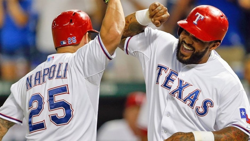 The Texas Rangers' Mike Napoli celebrates his two-run home run with Prince Fielder against the Detroit Tigers during the third inning on Wednesday, Sept. 30, 2015, at Globe Life Park in Arlington, Texas. (Jim Cowsert/Fort Worth Star-Telegram/TNS via Getty Images)