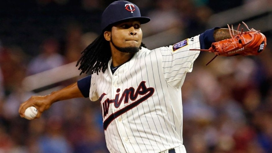 Minnesota Twins pitcher Ervin Santana throws against the Detroit Tigers in the first inning of a baseball game, Wednesday, Sept. 16, 2015, in Minneapolis. (AP Photo/Jim Mone)