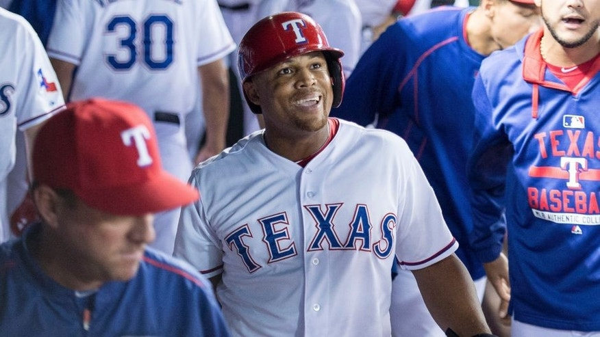 Oct 1, 2015; Arlington, TX, USA; Texas Rangers third baseman Adrian Beltre (29) checks out the replay screen after scoring against the Los Angeles Angels during the seventh inning at Globe Life Park in Arlington. The Rangers defeat the Angels 5-3. Mandatory Credit: Jerome Miron-USA TODAY Sports