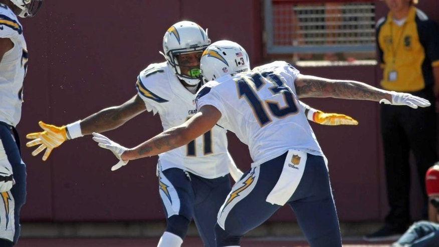 San Diego Chargers wide receiver Keenan Allen (right) celebrates with Steve Johnson after scoring a touchdown against the Minnesota Vikings in the first half in Minneapolis on Sunday, Sept. 27, 2015.