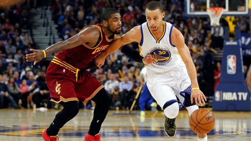 Jan 9, 2015; Oakland, CA, USA; Golden State Warriors guard Stephen Curry (30) drives past Cleveland Cavaliers guard Kyrie Irving (2) in the third quarter at Oracle Arena. The Warriors defeated the Cavaliers 112-94. Mandatory Credit: Cary Edmondson-USA TODAY Sports