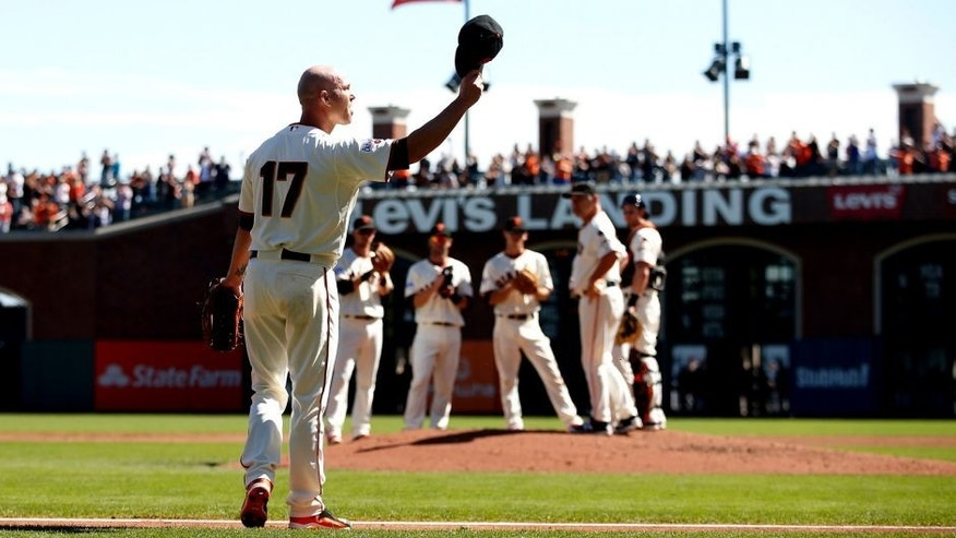 SAN FRANCISCO, CA - OCTOBER 01: Tim Hudson #17 of the San Francisco Giants waves to the crowd after being taken out of the game in the third inning of their game against the Los Angeles Dodgers in the first inning at AT&T Park on October 1, 2015 in San Francisco, California. (Photo by Ezra Shaw/Getty Images)
