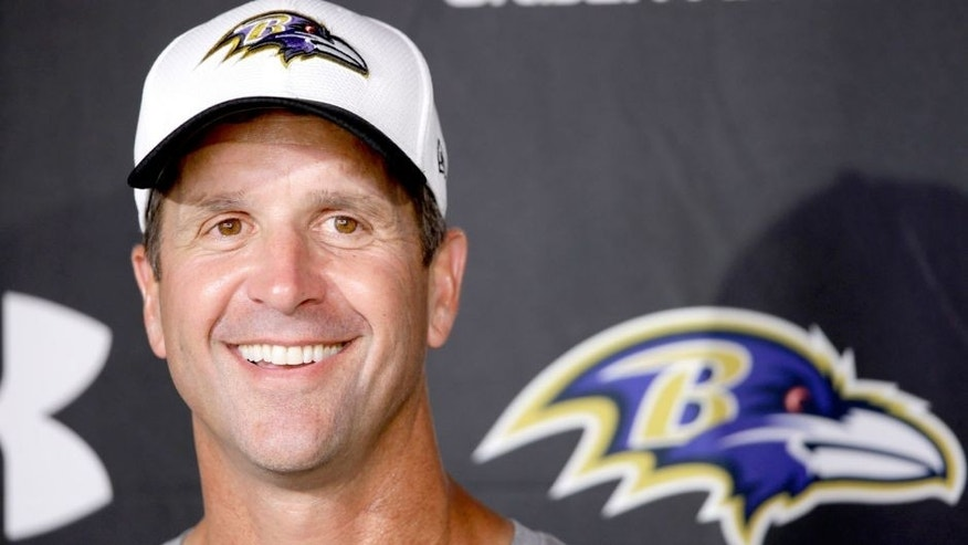 Baltimore Ravens head coach John Harbaugh speaks with members of the media after a joint practice with the Philadelphia Eagles at the Eagle's NFL football training camp, Wednesday, Aug. 19, 2015, in Philadelphia. (AP Photo/Matt Rourke)