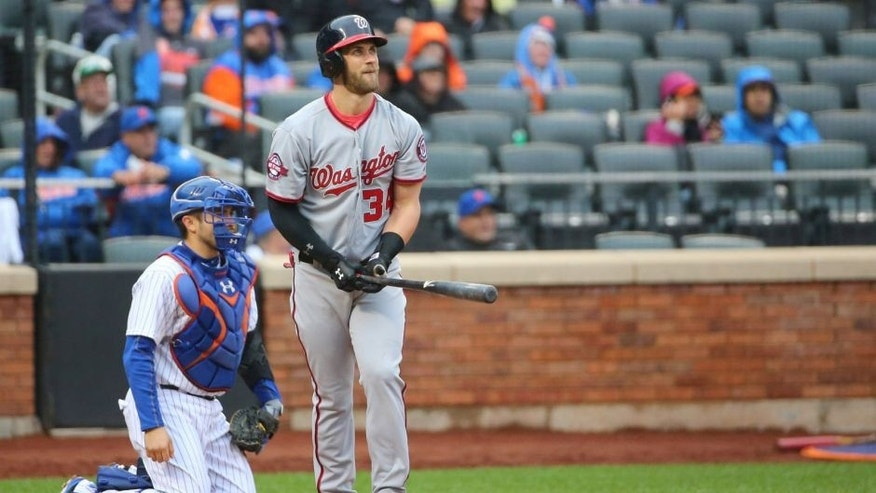 Oct 3, 2015; New York City, NY, USA; Washington Nationals right fielder Bryce Harper (34) watches his home run ball during the eighth inning against the New York Mets at Citi Field. Washington Nationals won 3-1. Mandatory Credit: Anthony Gruppuso-USA TODAY Sports