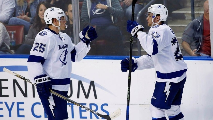 Oct 3, 2015; Sunrise, FL, USA; Tampa Bay Lightning left wing Jonathan Drouin (27) celebrates his game winning goal with defenseman Matt Carle (25) in the third period of a game against the Florida Panthers at BB&T Center. The Lightning won 3-2. Mandatory Credit: Robert Mayer-USA TODAY Sports