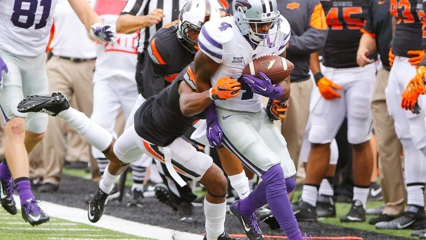 Oct 3, 2015; Stillwater, OK, USA; Kansas State Wildcats wide receiver Dominique Heath (4) is pushed out of bounds against the Oklahoma State Cowboy during the first quarter at Boone Pickens Stadium. Mandatory Credit: Alonzo Adams-USA TODAY Sports