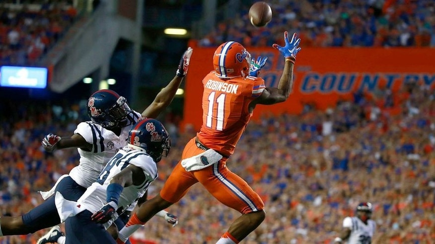 Oct 3, 2015; Gainesville, FL, USA; Florida Gators wide receiver Demarcus Robinson (11) catches the ball for a touchdown over Mississippi Rebels defensive back Mike Hilton (38) during the first quarter at Ben Hill Griffin Stadium. Mandatory Credit: Kim Klement-USA TODAY Sports