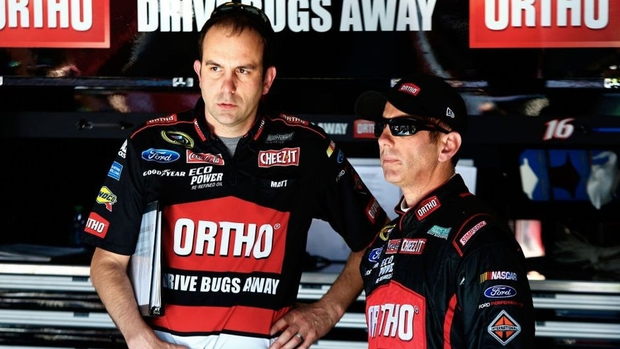 TALLADEGA, AL - MAY 01: Greg Biffle, driver of the #16 Ortho Ford, talks to his crew chief, Matt Puccia, in the garage area during practice for the NASCAR Sprint Cup Series GEICO 500 at Talladega Superspeedway on May 1, 2015 in Talladega, Alabama. (Photo by Jerry Markland/Getty Images)