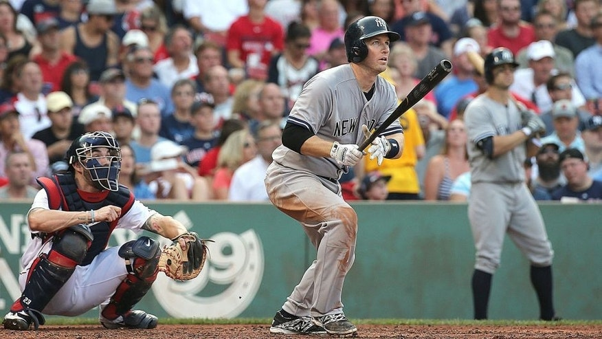 BOSTON, MA - SEPTEMBER 2: Stephen Drew #14 of the New York Yankees hits a three-run home run in the third inning against he Boston Red Sox at Fenway Park on September 2, 2015 in Boston, Massachusetts. (Photo by Jim Rogash/Getty Images)