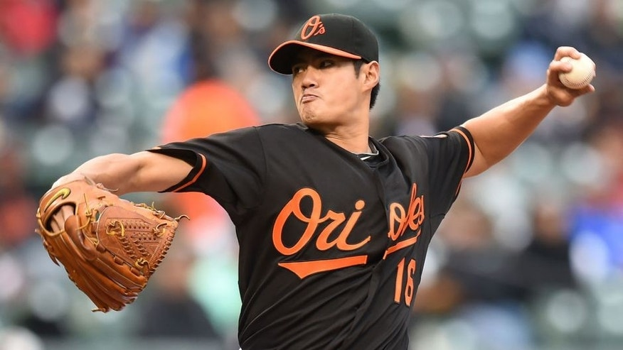 BALTIMORE, MD - OCTOBER 03: Wei-Yin Chen #16 of the Baltimore Orioles pitches in third inning during game one of a baseball game against the New York Yankees at Oriole Park at Camden Yards on October 3, 2015 in Baltimore, Maryland. (Photo by Mitchell Layton/Getty Images)