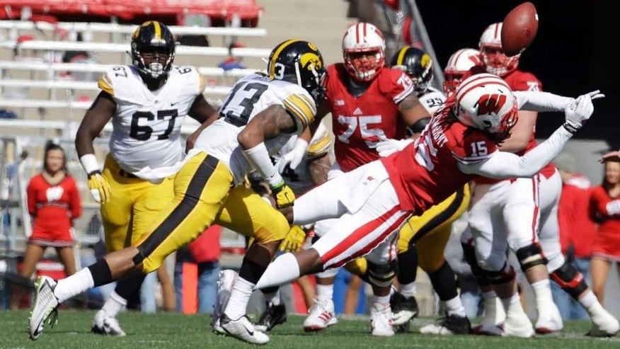 Wisconsin's Robert Wheelwright can't hang onto a pass in front of Iowa's Greg Mabin during the first half of an NCAA college football game in Madison, Wis., on Saturday, Oct. 3, 2015.