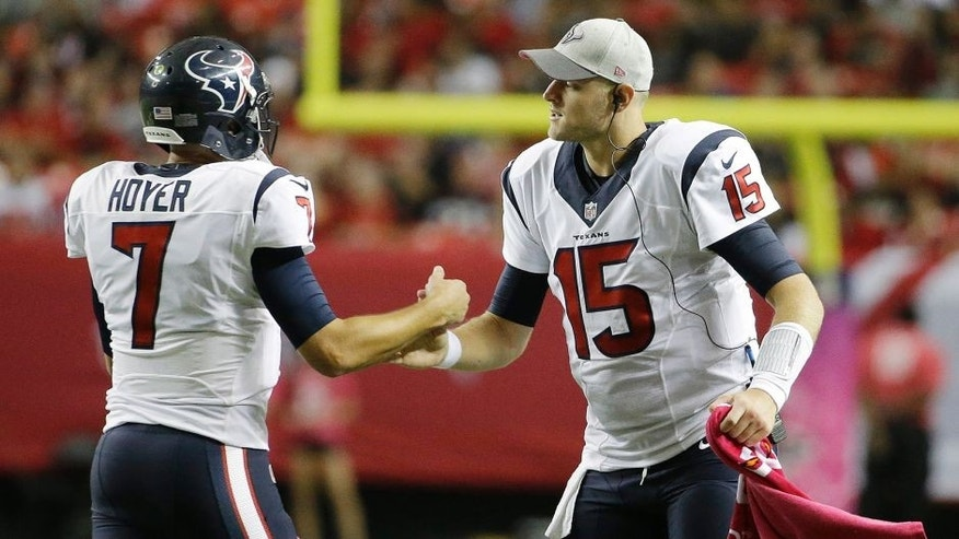 Houston Texans quarterback Ryan Mallett (15) congratulates Houston Texans quarterback Brian Hoyer (7) after Hoyer through a touchdown passs against the Atlanta Falcons during the second half of an NFL football game, Sunday, Oct. 4, 2015, in Atlanta. (AP Photo/David Goldman)