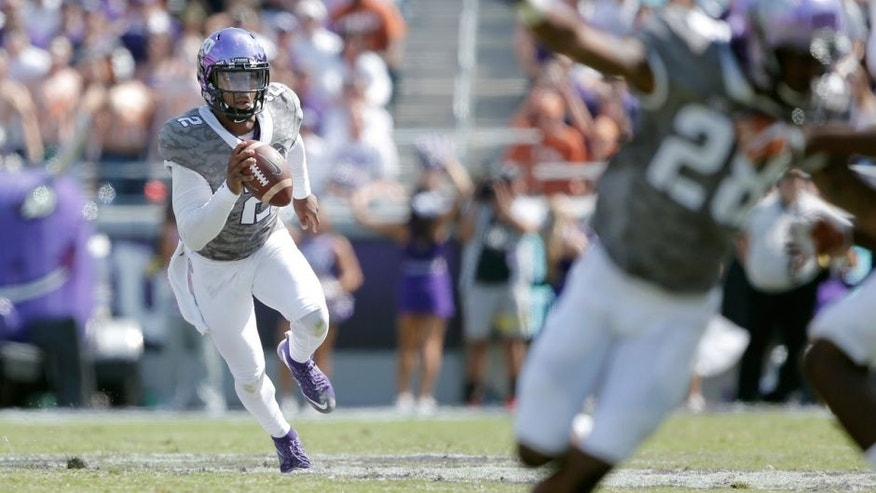 Oct 3, 2015; Fort Worth, TX, USA; Texas Christian University Horned Frogs quarterback Trevone Boykin (2) scrambles against the University of Texas Longhorns in the third quarter at Amon G. Carter Stadium. Mandatory Credit: Erich Schlegel-USA TODAY Sports