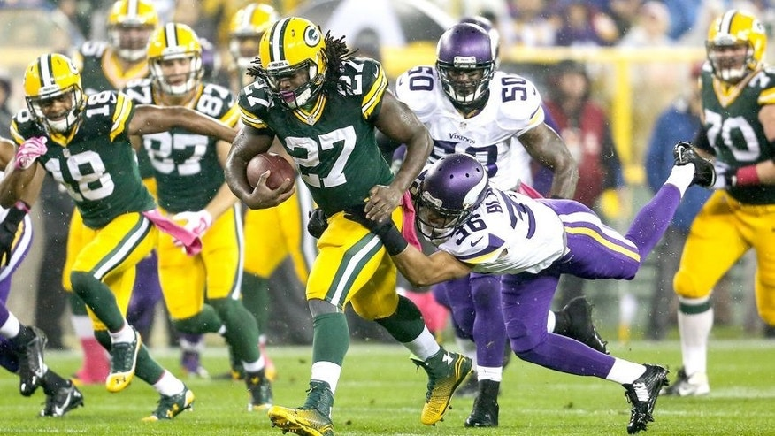 GREEN BAY, WI - OCTOBER 2: Eddie Lacy #27 of the Green Bay Packers carries the football against Robert Blanton #36 of the Minnesota Vikings in the first half of the NFL game on October 02, 2014 at Lambeau Field in Green Bay, Wisconsin. (Photo by John Konstantaras/Getty Images)