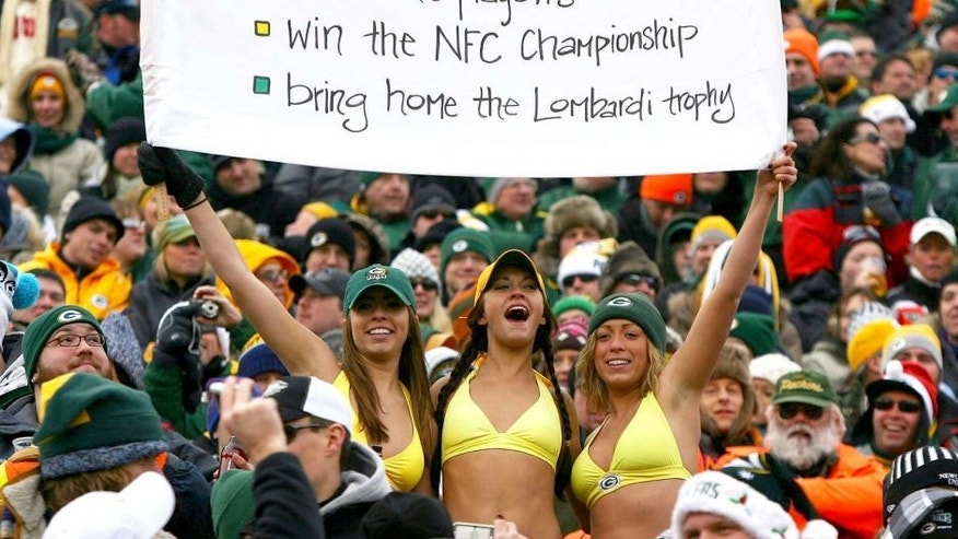 GREEN BAY, WI - DECEMBER 27: Fans of the Green Bay Packers hold a sign and wear bikini's in below freezing weather during a game between the Packers and the Seattle Seahawks at Lambeau Field on December 27, 2009 in Green Bay, Wisconsin. The Packers defeated the Seahawks 48-10. (Photo by Jonathan Daniel/Getty Images)