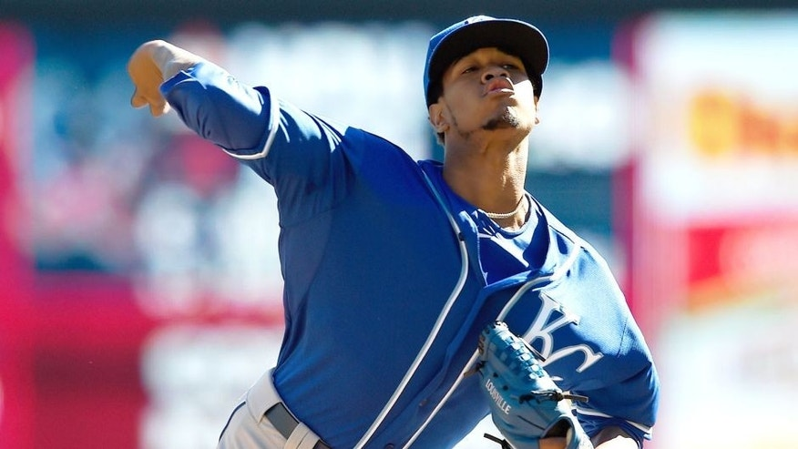 MINNEAPOLIS, MN - OCTOBER 3: Yordano Ventura #30 of the Kansas City Royals delivers a pitch against the Minnesota Twins during the first inning of the game on October 3, 2015 at Target Field in Minneapolis, Minnesota. (Photo by Hannah Foslien/Getty Images)