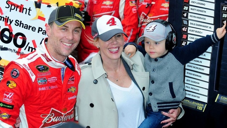 DOVER, DE - OCTOBER 04: Kevin Harvick, driver of the #4 Budweiser/Jimmy John's Chevrolet, wife DeLana and son Keelan celebrate in victory lane after winning the NASCAR Sprint Cup Series AAA 400 at Dover International Speedway on October 4, 2015 in Dover, Delaware. (Photo by Will Schneekloth/Getty Images)