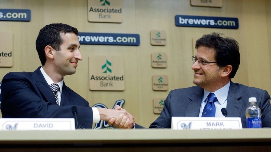 <p>David Stearns shakes hands with Milwaukee Brewers owner Mark Attanasio during a news conference Monday, Sept. 21, 2015, in Milwaukee. Stearns was introduced as the Brewers' new general manager. (AP Photo/Morry Gash)</p>