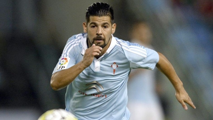 Celta Vigo's forward Nolito chases the ball during the Spanish league football match Celta Vigo vs Getafe CF at the Balaidos stadium in Vigo on October 2, 2015. AFP PHOTO / MIGUEL RIOPA (Photo credit should read MIGUEL RIOPA/AFP/Getty Images)