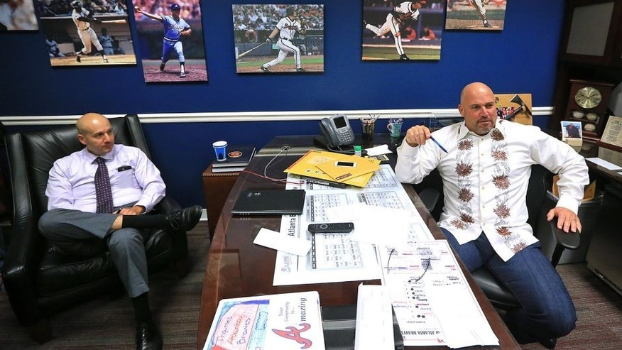 Atlanta Braves manager Fredi Gonzalez, right, and general manager John Coppolella hold end of season interviews Monday, Oct. 5, 2015, in Atlanta. Atlanta finished the season with 67 wins, under 70 wins in a full season for the first time since 1990. (Curtis Compton /Atlanta Journal-Constitution via AP) MARIETTA DAILY OUT; GWINNETT DAILY POST OUT; LOCAL TELEVISION OUT; WXIA-TV OUT; WGCL-TV OUT; MANDATORY CREDIT