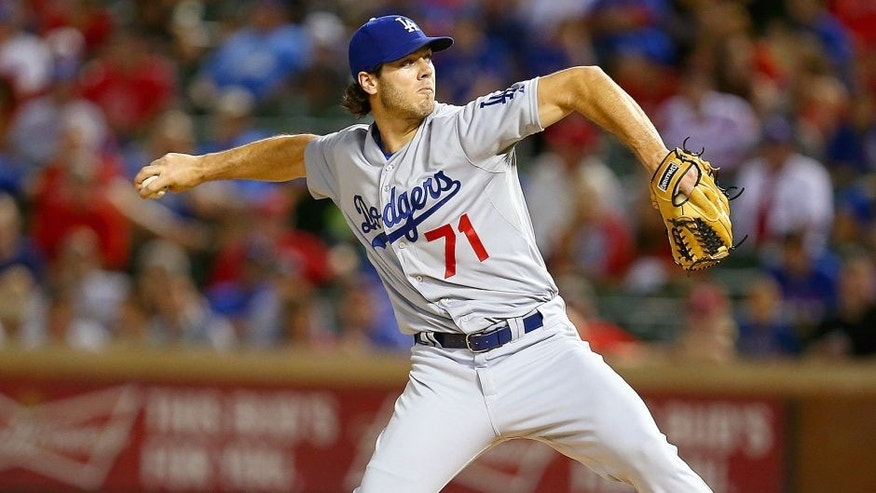 ARLINGTON, TX - JUNE 16: Josh Ravin #71 of the Los Angeles Dodgers pitches in the ninth inning during a game against the Texas Rangers at Globe Life Park in Arlington on June 16, 2015 in Arlington, Texas. The Texas Rangers defeated the Los Angeles Dodgers 3-2. (Photo by Sarah Crabill/Getty Images)